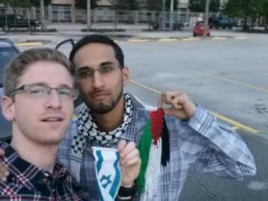 Sholom and Moe take a selfie together with their respective flags.