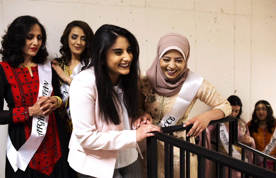 Friends laugh backstage before the start of the Modest Muslim Women's Fashion Show. Saturday, April 20, 2019