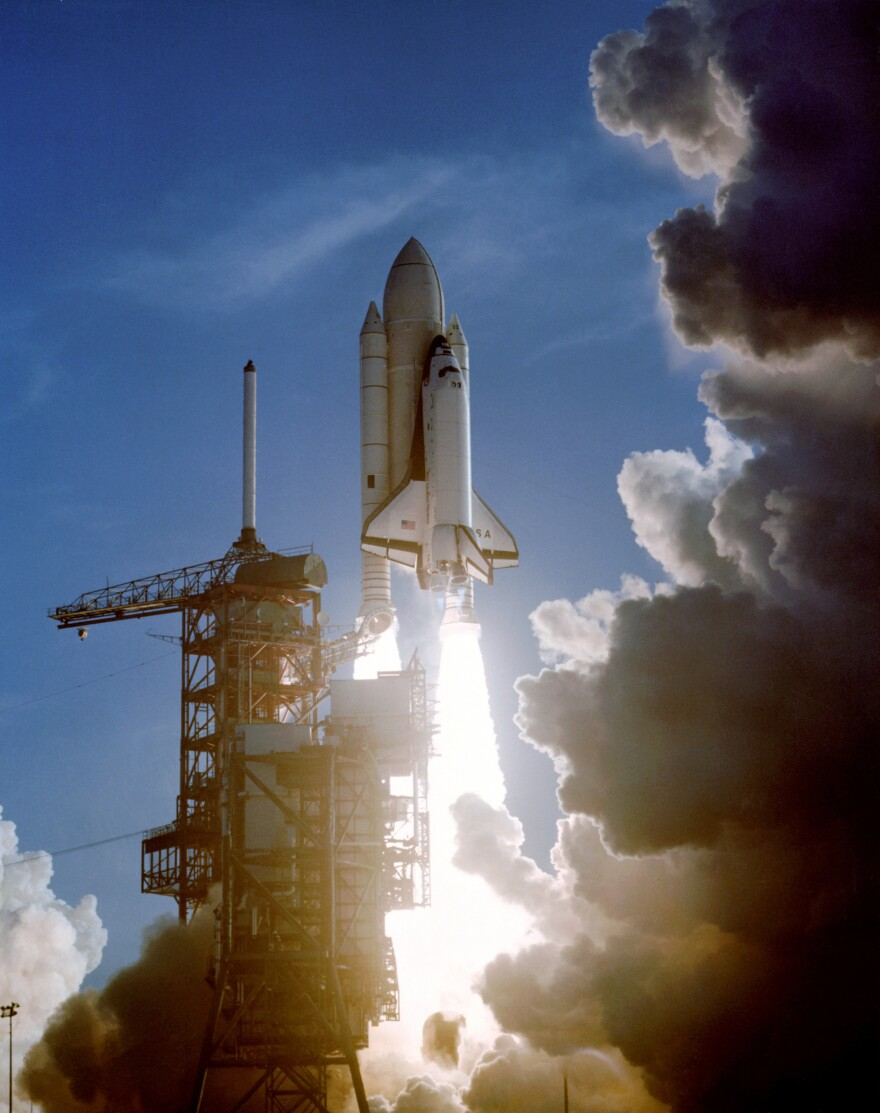 The first orbital mission of the space shuttle lifts off from the Kennedy Space Center on April 12, 1981.