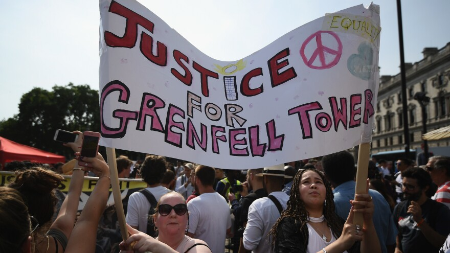 "Protesters in London on Wednesday call for justice for the victims of the Grenfell Tower blaze. They joined other demonstrators in what they called a ""day of rage"" to protest perceived government inaction and neglect."