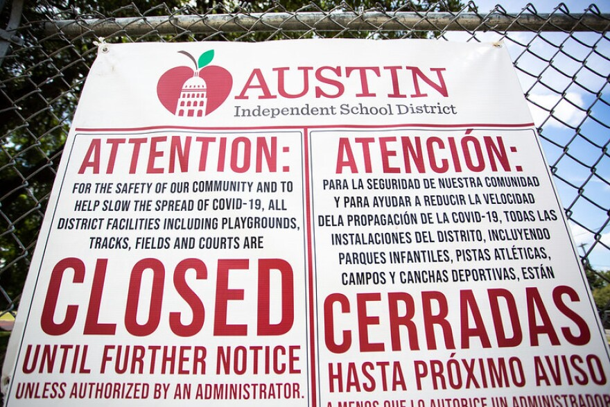 A sign at Lively Middle School in South Austin over the summer notes that district facilities such as playgrounds are closed because of the coronavirus pandemic.