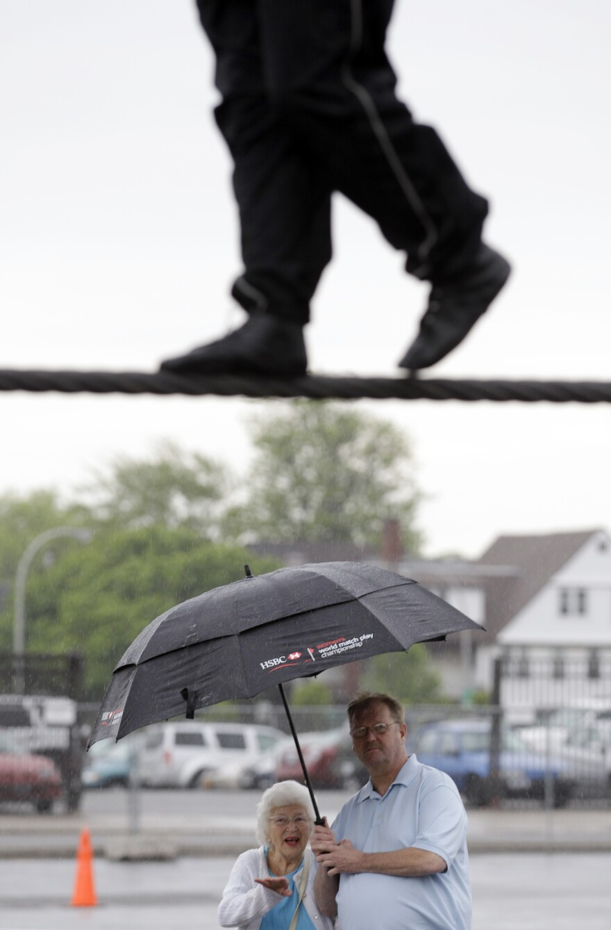 Spectators watch Nik Wallenda practice in Niagara Falls, N.Y. Local officials are hoping the stunt revives flagging tourism.