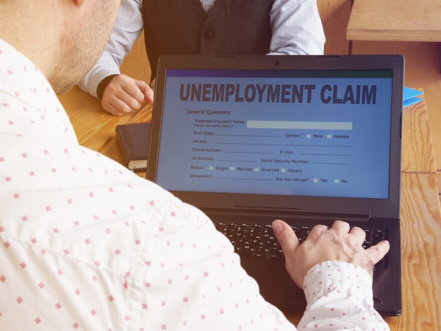 Man filling out an unemployment claim.