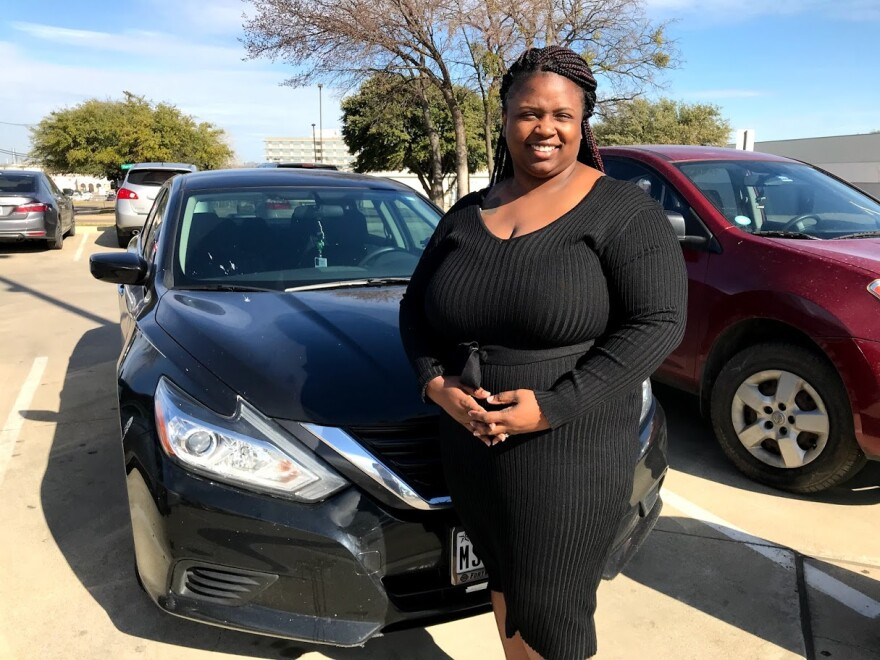 Ashley Bryant stands with her black Nissan.