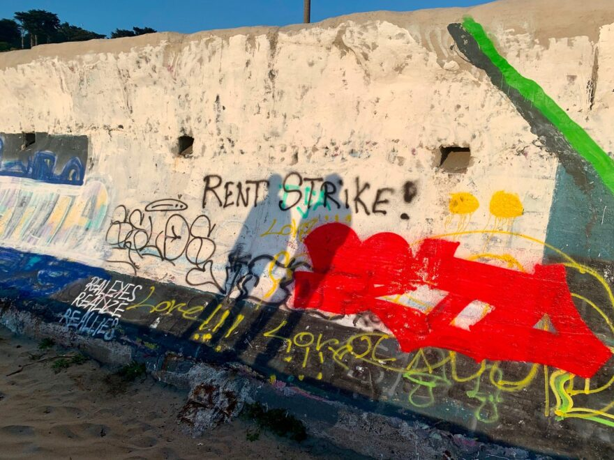 Graffiti painted on a wall at Ocean Beach in San Francisco calls tenants to go on a rent strike as millions of people find themselves in dire financial situations because of the pandemic and the lockdown.