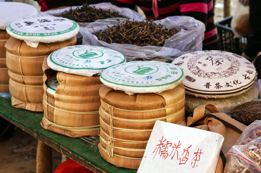 Pu'er tea is packed in <em>bings</em> at a market in China's Yunnan province. A cake of Pu'er continues to change as it ages, and bits of tea are chipped off in order to brew.