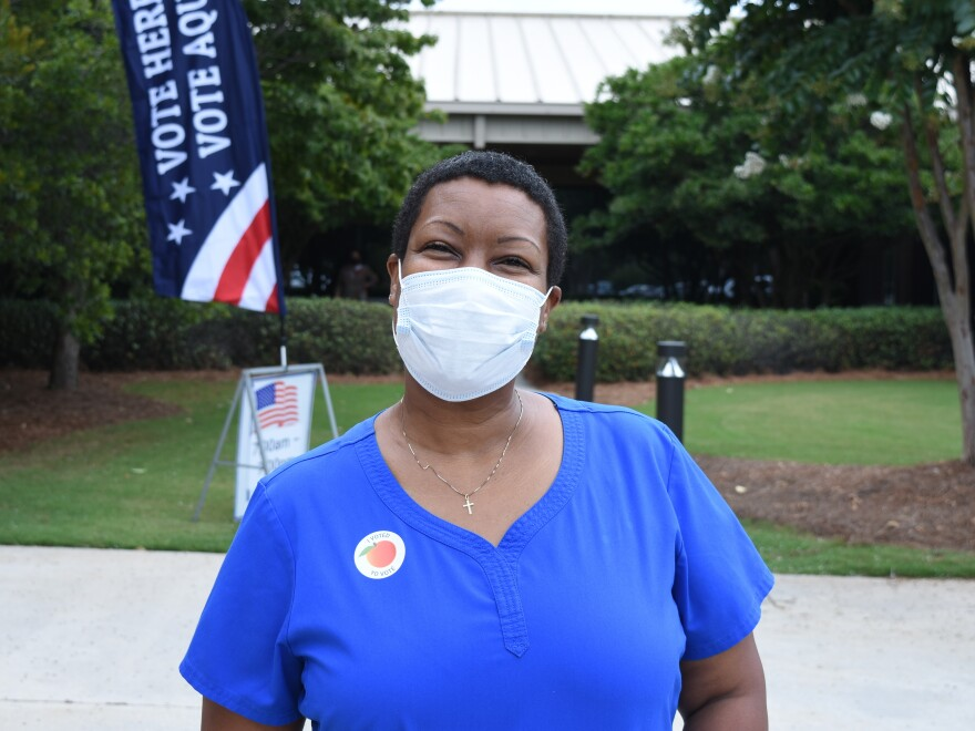 Angela Maddox after voting in a primary runoff in August.<em> </em>