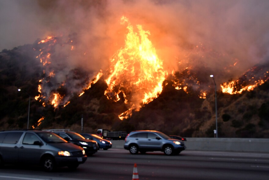 The Getty Fire burns near the Getty Center along the 405 freeway north of Los Angeles on Monday.