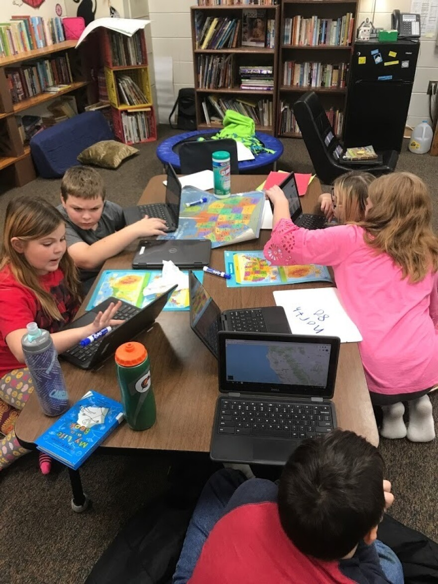 Fifth grade students at West Harrison Elementary School in Mondamin, Iowa play a game of Mystery Skype.