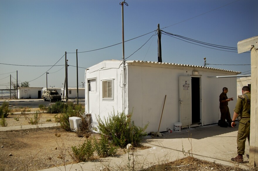 A white metal trailer serves as the makeshift synagogue at the West Bank outpost of an all-ultra-Orthodox Israeli military platoon.