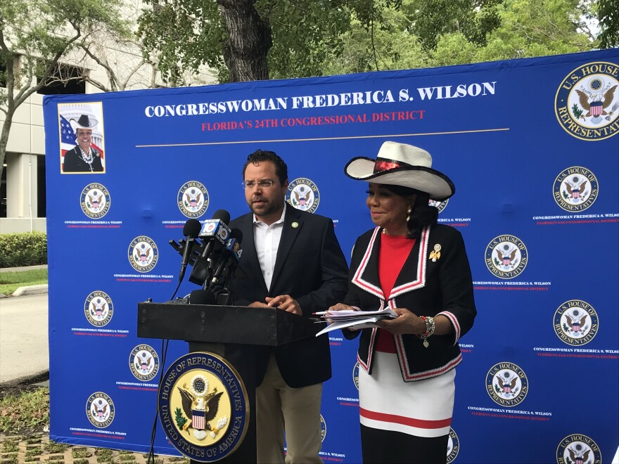 Congresswoman Frederica Wilson presents her congressional consortium's emergency preparedness and disaster response guide Friday morning, with Hollywood Mayor Josh Levy outside the, now closed, Rehabilitation Center At Hollywood Hills.