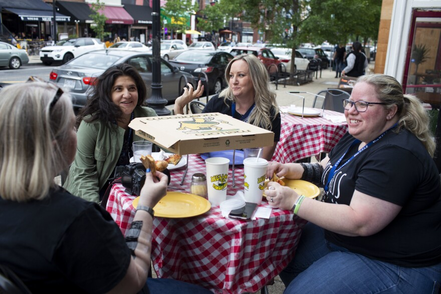 Erin Gibson (from left), Melissa Swailes, Kristen Clifford and Nicole Rikard share pizza after getting matching tattoos in Washington, D.C.