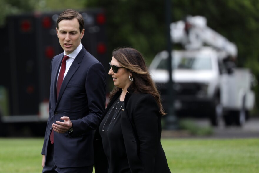 Republican National Committee Chair Ronna McDaniel, right, walks with White House senior adviser Jared Kushner on the South Lawn of the White House in May. McDaniel announced Thursday that the RNC would scale back its convention plans in Jacksonville, Fla. due to the coronavirus pandemic.