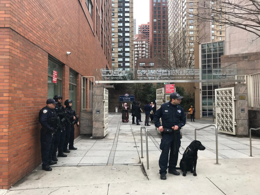 The New York Police Department's counterterrorism unit stationed heavily armed officers outside a number of New York City mosques and other religious institutions on Friday.