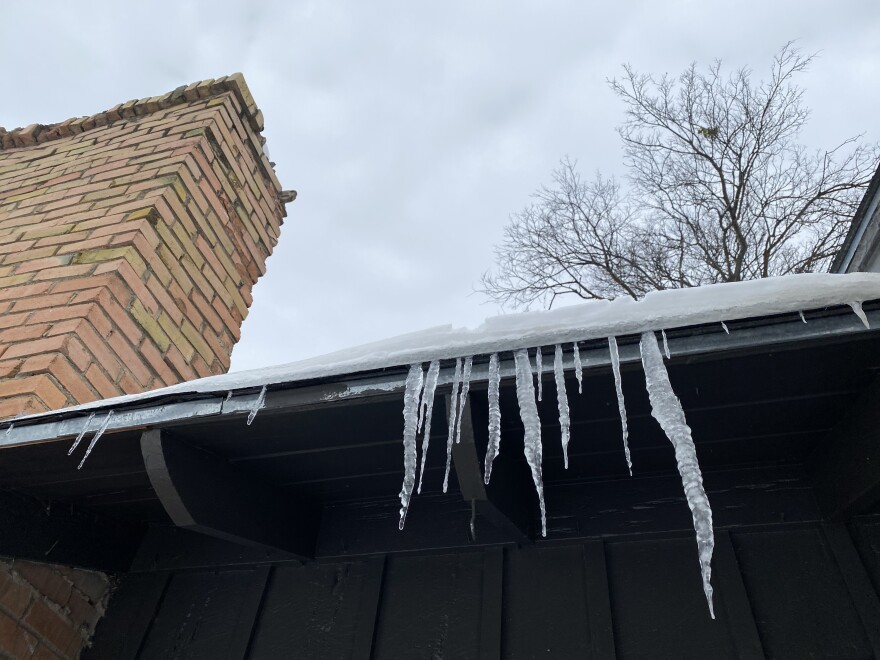 Icicles hanging from the edge of the roof of a home in Dallas.