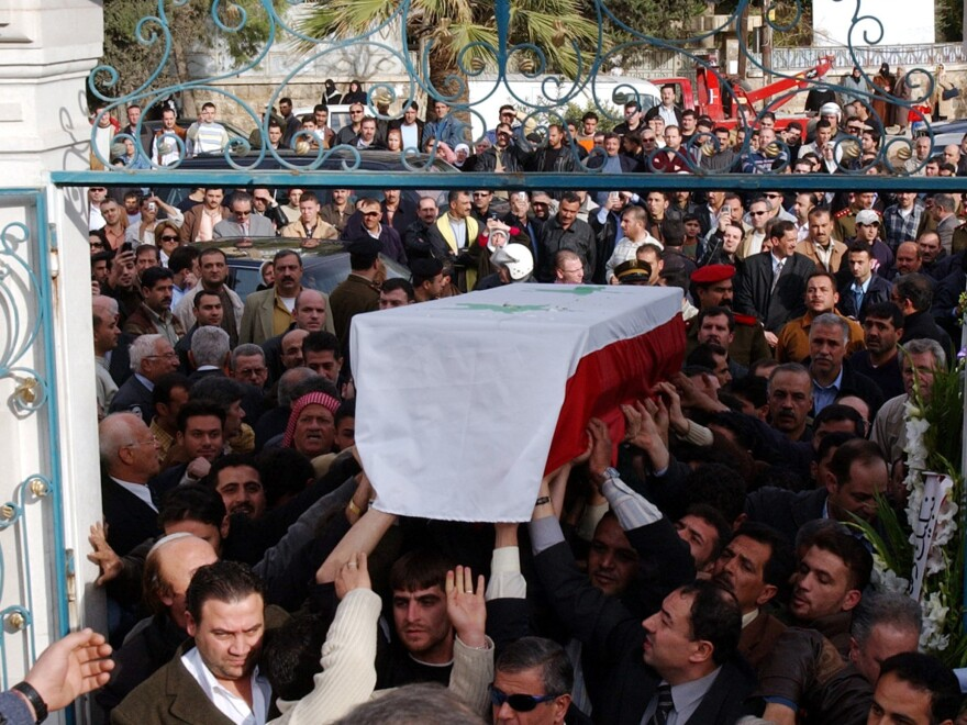 Mourners carry the coffin of filmmaker Moustapha Akkad in Aleppo, Syria, on Nov. 13, 2005. Akkad and his daughter Rima were killed in a suicide bombing in Jordan.