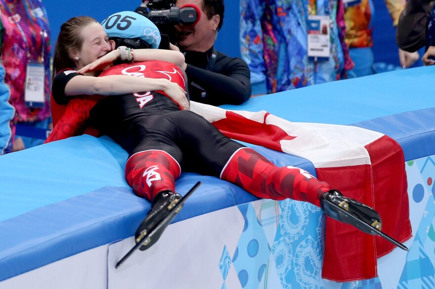 Gold medalist Charles Hamelin of Canada celebrates with his girlfriend and fellow speedskater, Marianne St-Gelais, after winning the men's 1500-meter short-track speedskating event Monday.