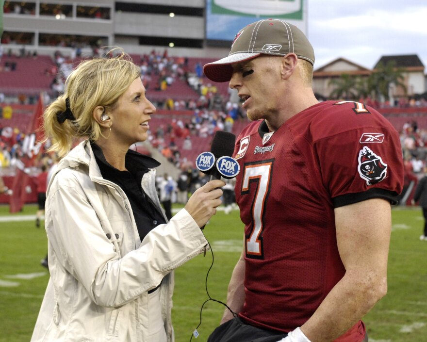 FOX sideline reporter Laura Okmin talks with quarterback Jeff Garcia of the Tampa Bay Buccaneers in a 2008 game against the New Orleans Saints.