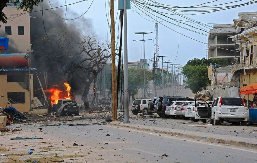 Fire is seen at the scene of a car bomb attack claimed by Al-Qaeda-affiliated Shabab militants on the Naasa Hablod hotel in Mogadishu on Saturday.
