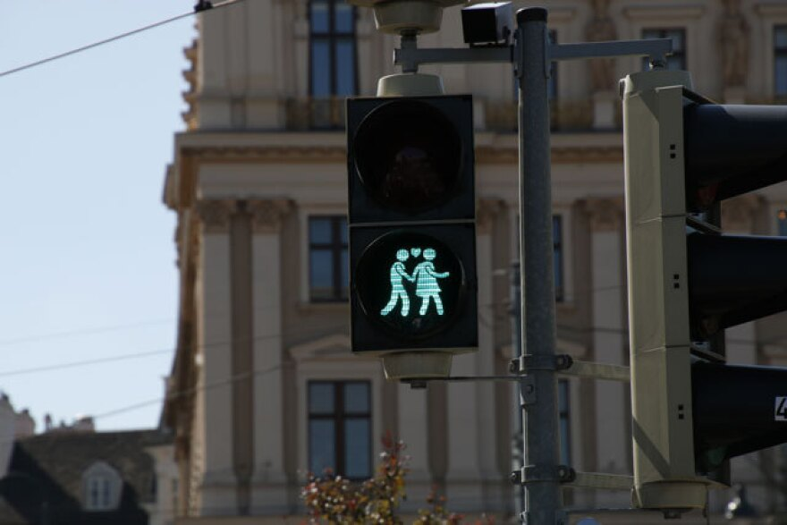 An opposite sex couple is shown on a crosswalk signal in Vienna.