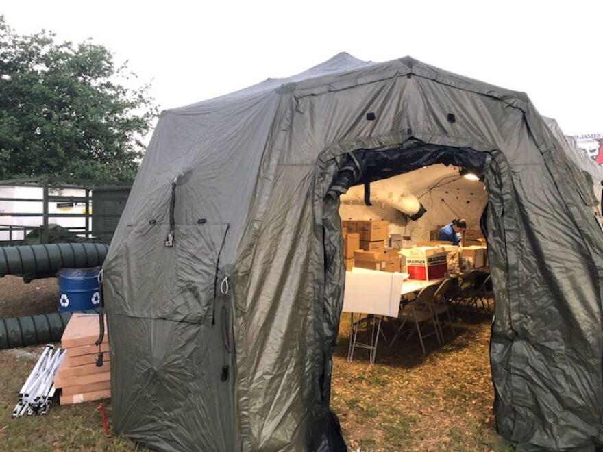 A testing supply tent set up outside Raymond James Stadium