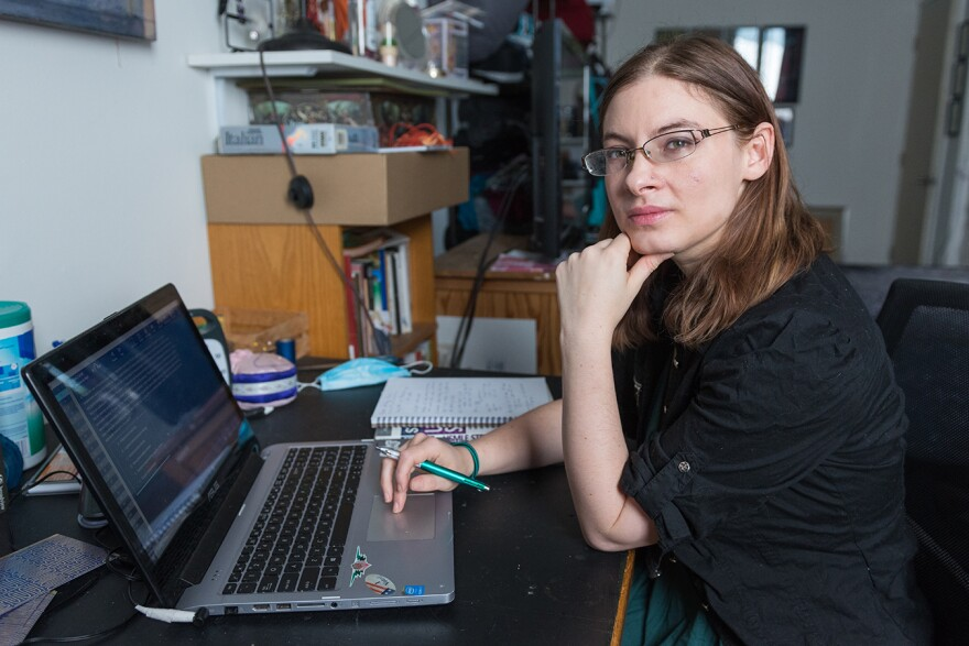 woman medical student typing into laptop