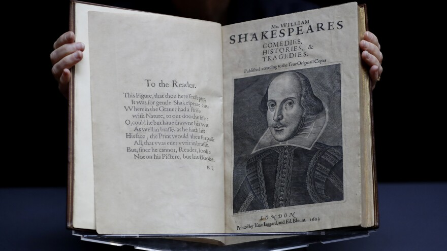 William Shakespeare's First Folio is displayed at Christie's auction rooms in London, Monday, Jan. 13, 2020. The book was published in 1623 and contains 36 of Shakespeare's plays.