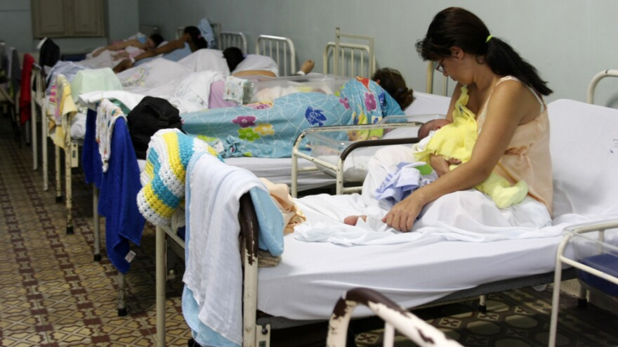 Brazil's fertility rate has dropped dramatically over the past half-century and is now below that in the U.S. Here, women lie with their newborns at the Pro Matre maternity hospital in Rio de Janeiro.