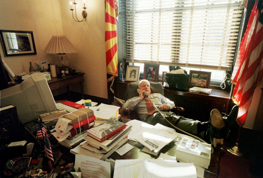 McCain makes a phone call while working in his Capitol Hill office during the Senate debate of the McCain-Feingold campaign finance reform bill in March 2001. McCain tackled the system of campaign financing with like-minded Democrats, an issue that split him from Republican leaders.