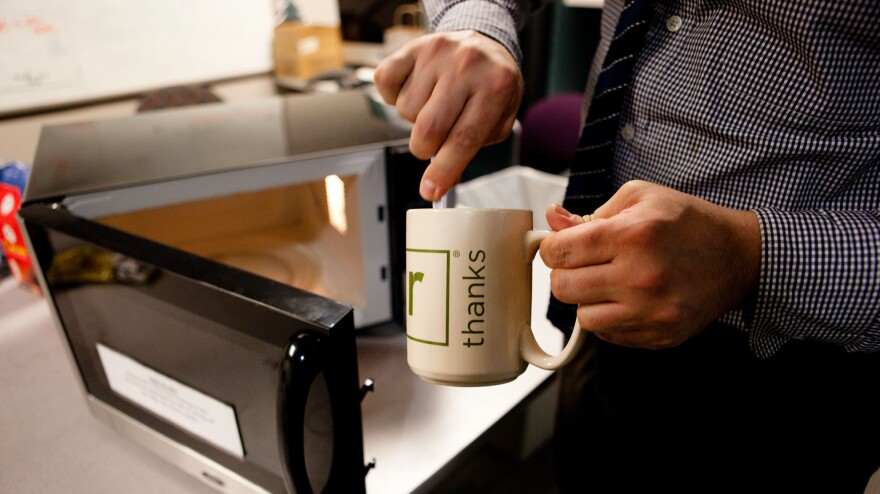 <em>Washington Post</em> Food and Travel Editor Joe Yonan whips up some macaroni and cheese in an NPR mug.