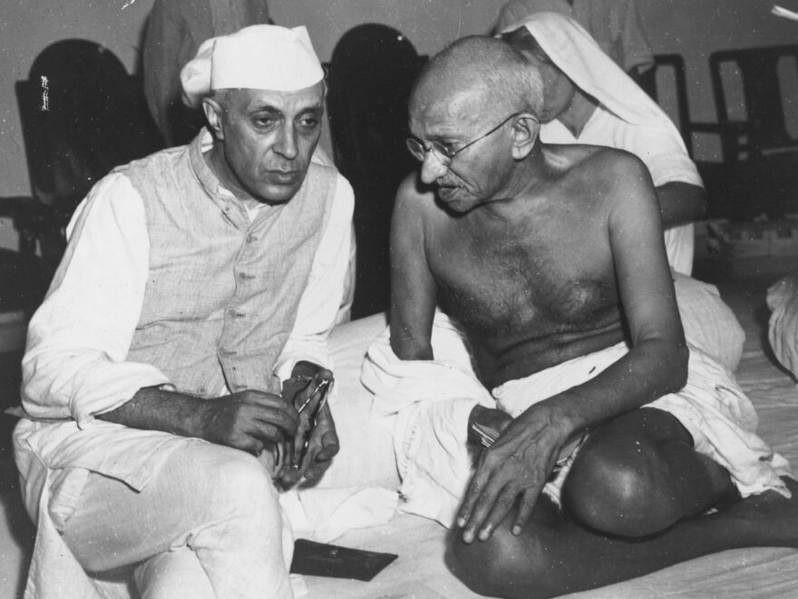 Jawaharlal Nehru, here conferring with Mahatma Gandhi, was India's first prime minister and a key figure in the country's 20th century independence struggle.