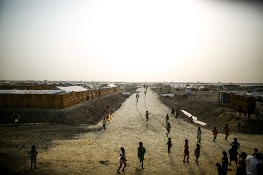 A dirt road cuts through a sprawling refugee camp in South Sudan where Doctors Without Borders has a hospital. In a letter, 1,000 current and former employees are accusing the aid group of racism and white supremacy.
