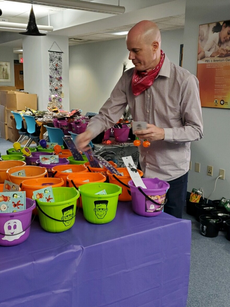 Programming Director Eddie Isom prepares Halloween treats for WVPB's Trick-or-Treat event, Thursday, October 29, at 600 Capitol Street in Charleston. The fun starts at 4 p.m. and we will give away buckets until 6 p.m. or they are gone. Social distancing and mask requirements apply.