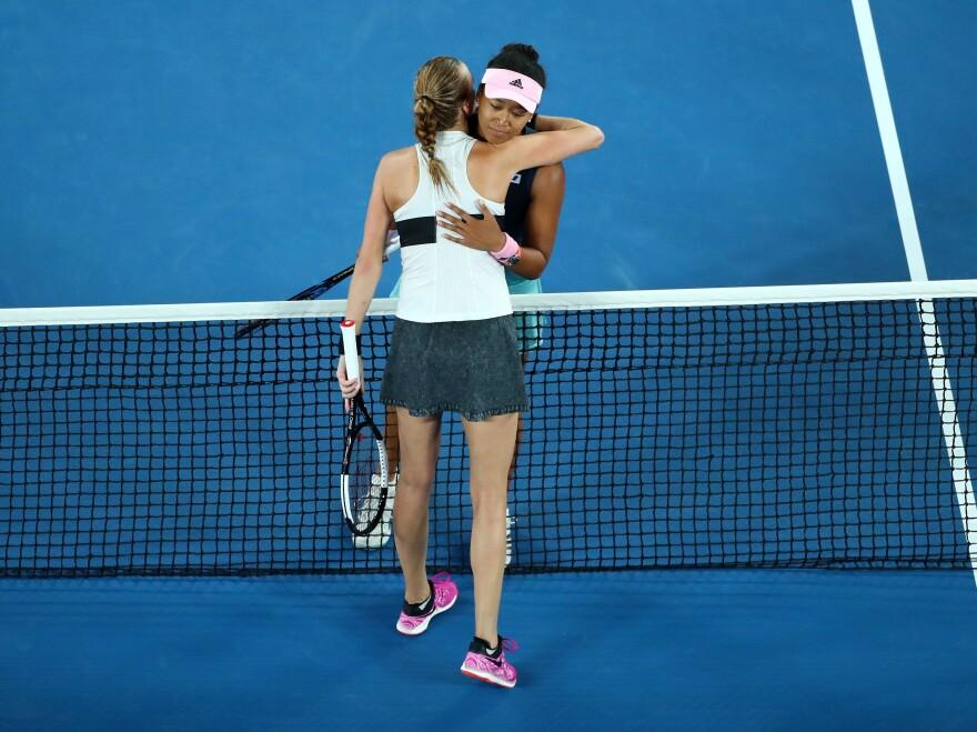 Naomi Osaka and Petra Kvitova embrace following Osaka's victory in the match.