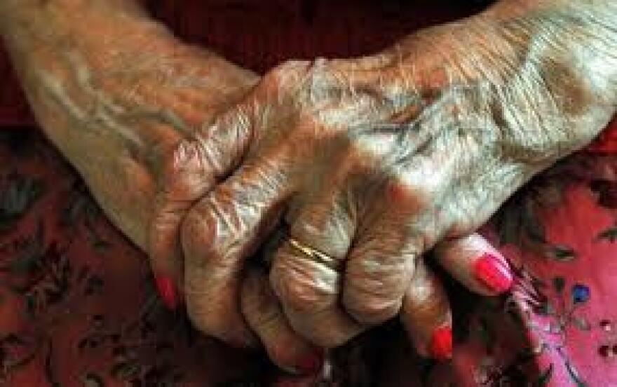 Elder hands clasped