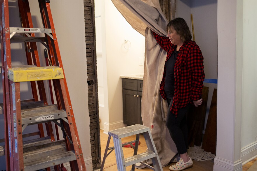 Grace Church member Christy Fry, who led the renovation crew, shows off the updates to the home on December 4, 2019.