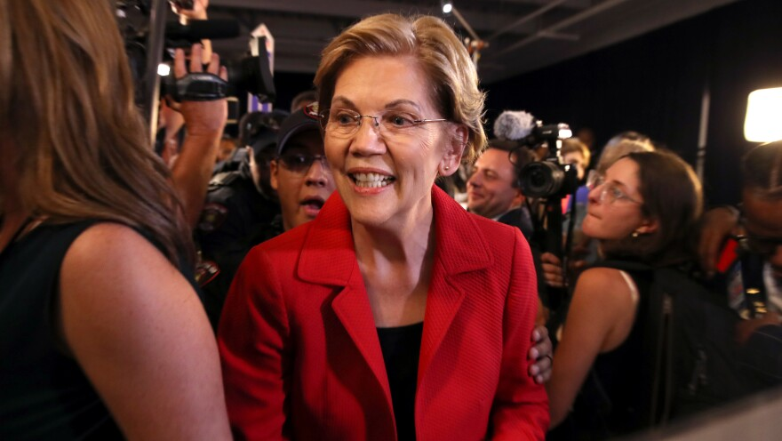 Sen. Elizabeth Warren talks to reporters after the Democratic presidential debate at Texas Southern University last September.