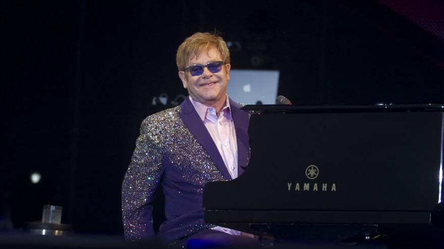 Elton John performs in Ibiza earlier this month. The British singer's new memoir is titled <em>Love Is the Cure</em>.