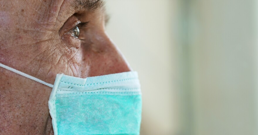 A photo of an elderly man wearing a face mask.