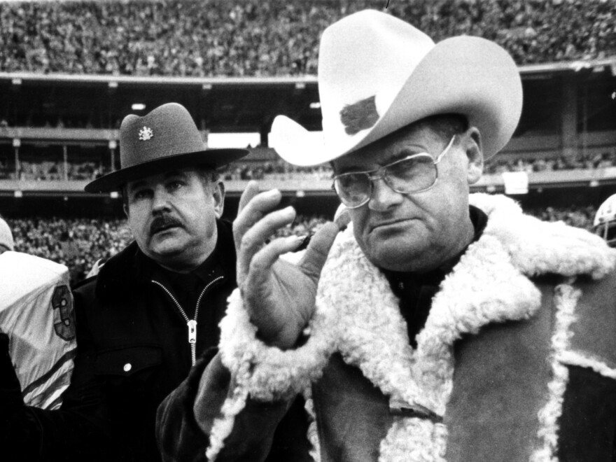 "Houston Oilers coach ""Bum"" Phillips sports his trademark coat and cowboy hat as he leaves the field after losing to the Steelers in AFC championship in Pittsburgh in 1980."
