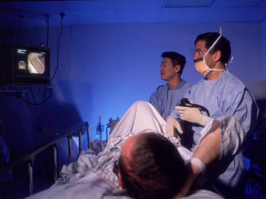 No anesthesia here: A patient watches his colonoscopy as it happens at Memorial Sloan-Kettering Hospital in New York.