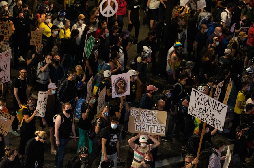 A subsection of the crowd marches toward the Marriott hotel in downtown Portland on Saturday.