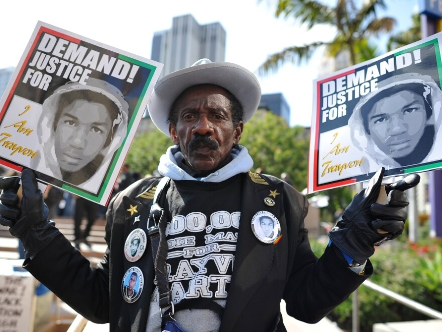 A man joins nationwide protests in memory of slain Florida teenager Trayvon Martin, in downtown Los Angeles on Monday.