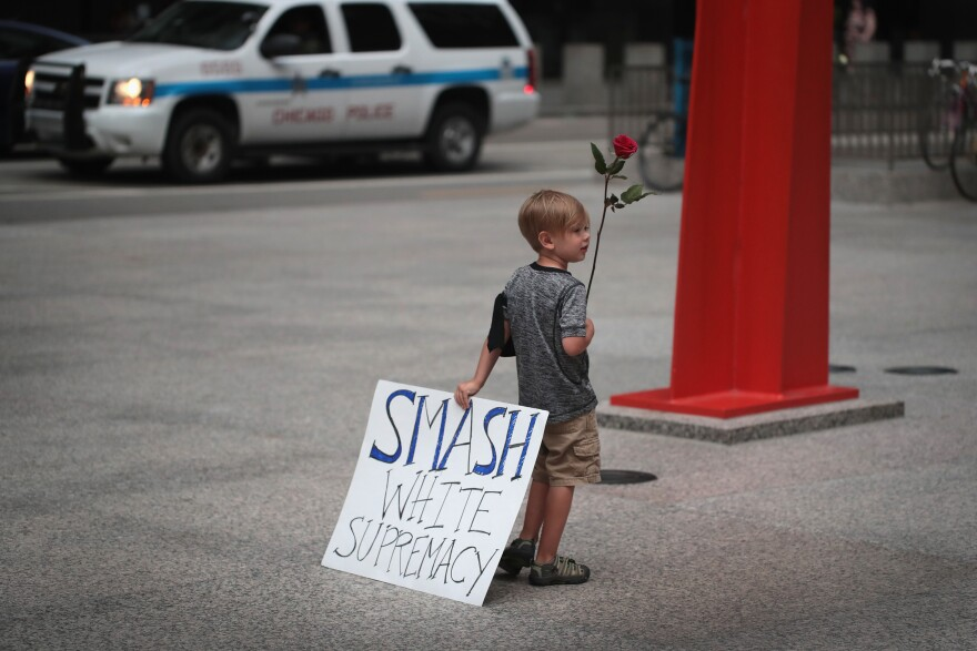 Four-year-old Leo Griffin leaves a Chicago protest against the alt-right movement held to mourn the victims of Charlottesville, Va.