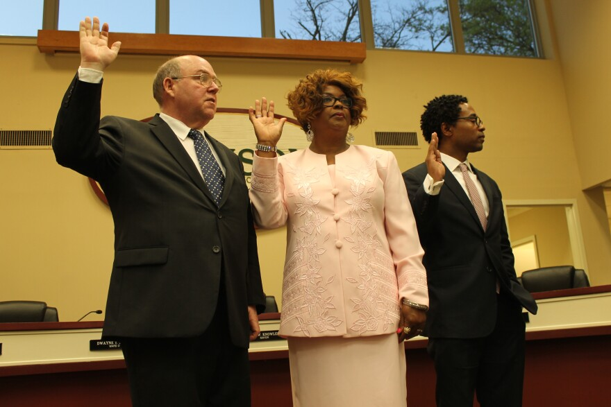 Ferguson City Councilmembers Brian Fletcher, Ella Jones and Wesley Bell take their oaths of office on Tuesday.