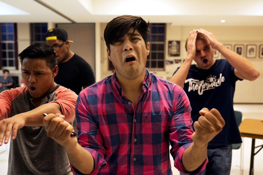 """Kelvin Urday, center, rehearses """"21 Chump Street"""" with, from left to right, Kevin Corpuz, Omega Jones and Phil Leveling."""