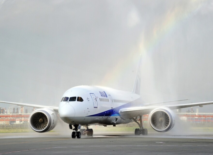 <p>A Boeing 787 Dreamliner arrives at Tokyo's Haneda airport as fire engines spray it with water during a test flight.</p>