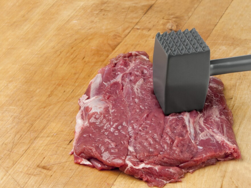 Meat tenderized the old-fashioned way. The industrial method is a mechanized process involving needles.