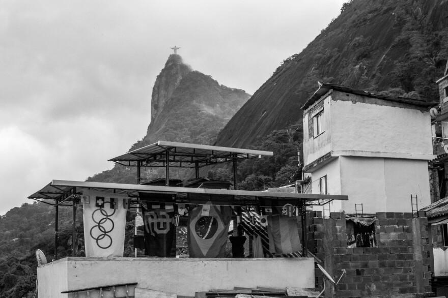 The Christ the Redeemer statue is visible above the Santa Marta <em>favela</em> in Rio de Janeiro.