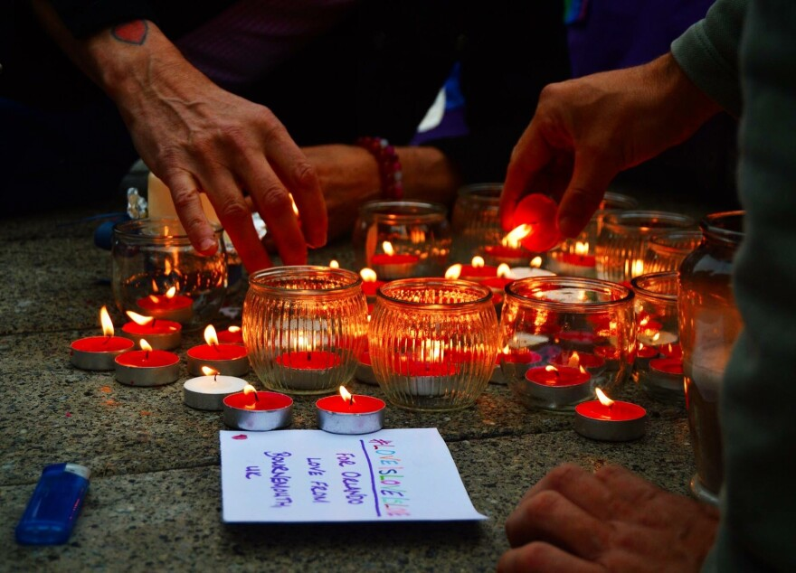 Mourners in Bournemouth, England light candles for the victims of the Orlando nightclub shooting.
